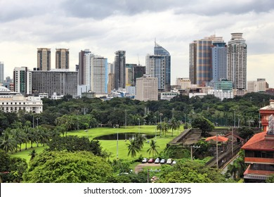 Manila city skyline in Philippines. Ermita and Paco districts seen from Intramuros.