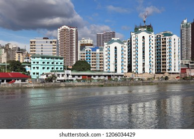 Manila city skyline in Philippines. Residential towers and Pasig River.
