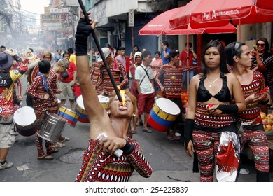 "MANILA - FEB. 19: Performers take part in the celebration of Chinese New Year on February 19, 2015 in Manila, Philippines. Thousands of Filipino-Chinese celebrate in the street. ""Public-Event"""