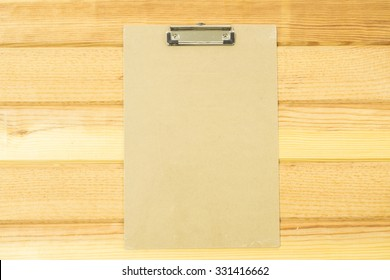 Manila File Folder on White. White paper hang on wood background, Stack of paper with clip.on wooden background.