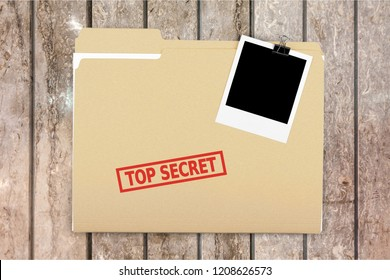 A manila folder with the faded words