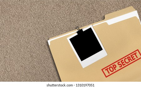 A manila folder with the faded words Top Secret on the front, isolated on  background