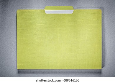 Manila folder with paper sheets on grey background