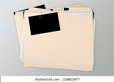 Manila folder with some documents in it. on background
