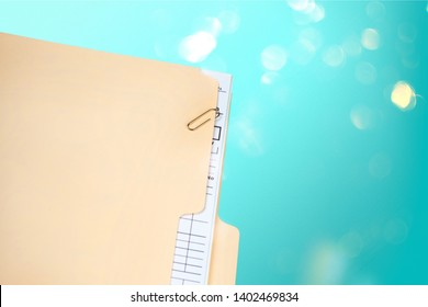 Manila folder with some documents in it. on a white background