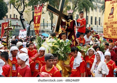 MANILA - JAN. 9: Devotee celebrate the feast of The Black Nazarene on January 9, 2011 in Manila Philippines. The fiesta celebrated by thousands devotee parading the image in the city.