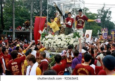 MANILA - JAN. 9: Devotees celebrate the feast of The Black Nazarene on January 9, 2012 in Manila Philippines. Image of the Black Nazarene procession around the city.