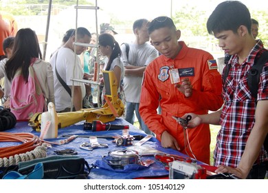 MANILA - JUNE 12: Military men show their gear to a civilian at The Philippines Independence day on June 12, 2012  in Manila. The Philippines celebrate the 114th Independence Day.