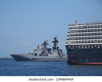 Manila, National Capital Region / April 13 2019: The Russian Federation navy warship RFS Admiral Tributs (564) exiting Manila South Harbor behind the MS Queen Elizabeth after a 5-day goodwill visit.