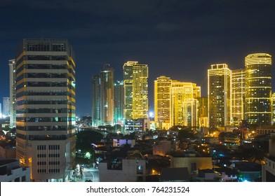 Manila at night. Skyscrapers in Makati