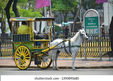 MANILA, PH - APR. 6: Horse-drawn calash (kalesa) at Intramuros on April 6, 2019 in Manila, Philippines.