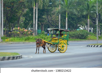 MANILA, PH - APR. 6: Kalesa, a horse carriage at Roxas Boulevard stretch road on April 6, 2019 in Manila, Philippines.