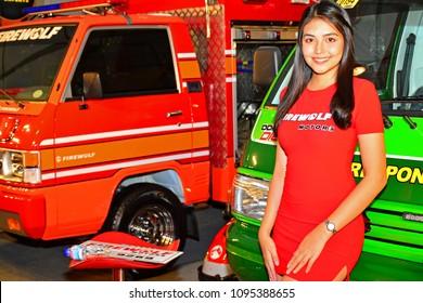 MANILA, PH - APR. 7: Firewolf Motors firetruck female model on April 7, 2018 in Manila, Philippines. Manila International Auto Show is a automotive trade show organized in Manila, Philippines.