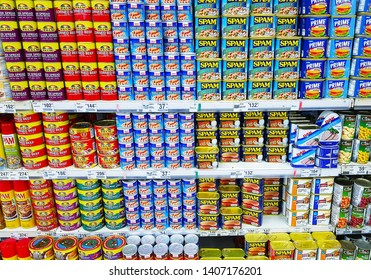 Manila, PH - APRIL 29, 2018: Various corned beef, sausages and instant beef meat in colorful cans, that sale on a shelf in a supermarket.