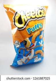 MANILA, PH - DEC. 18: Cheetos puffs on December 18, 2018 in Manila, Philippines. Cheetos brand is a manufacturer of junk food products in USA.