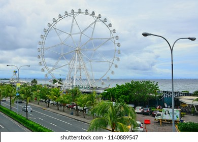 MANILA, PH - JULY 15: Mall of Asia (MOA) eye ferris wheel on July 15, 2018 in Manila, Philippines. Mall of Asia (MOA) eye is a view from above rotating ferris wheel located in the Philippines.
