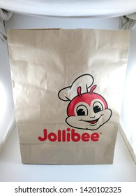 MANILA, PH - JUNE 10: Jollibee brown paper bag on June 10, 2019 in Manila, Philippines.