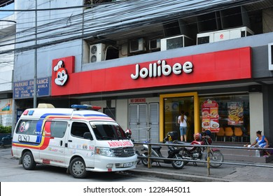 MANILA, PH - NOV. 13: Jollibee fast food restaurant General Luna branch facade on November 13, 2018 in Manila, Philippines. Jollibee brand name is a famous fast food restaurant in the Philippines.