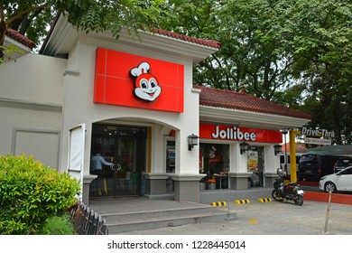 MANILA, PH - NOV. 13: Jollibee fast food restaurant Kalaw Avenue branch facade on November 13, 2018 in Manila, Philippines. Jollibee brand name is a famous fast food restaurant in the Philippines.