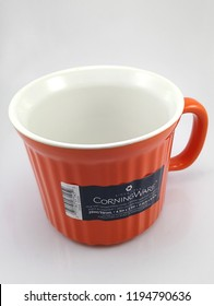 MANILA, PH - OCT. 4: Corning Ware orange mug on October 4, 2018 in Manila, Philippines. Corning Ware brand is a manufacturer of household ware products.