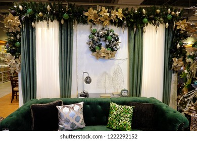 MANILA, PHILIPINES - 28 OCTOBER 2018: Sitting corner with classic green sofa and decorative pillows and golden and silver festive season ornaments around