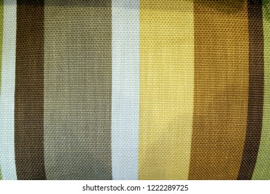 MANILA, PHILIPINES - 28 OCTOBER 2018:Background with fabric texture with stripes in warm earth colors grey brown and white
