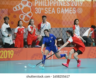 Manila, Philippine - Nov 27 2019 : Nelly Johansson (8) Floorball athletes of Thailand in action during SEA GAMES 2019 match between Thailand and Singapore at Gymnasium U.P. college.