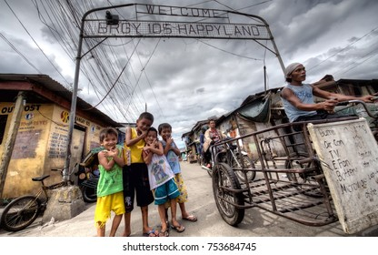 Manila / Philippines - 1 / 11 / 2014: Happyland, poor slum neighbourhood with children at the gate
