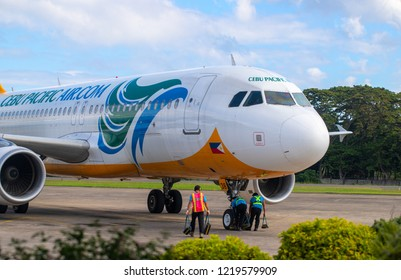 Manila, Philippines - 11 March, 2018: Cebu Pacific plane at airport before flight. Modern aircraft preparation for flight. Philippine low cost airline. Budget traveling by plane. Island hopping