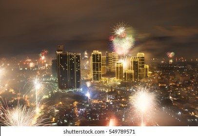 Manila, Philippines - 31 December 2016: 2017 New Years' Eve fireworks with Rockwell center in Makati illuminated
