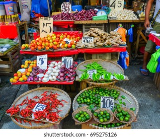 Manila, Philippines - Apr 12, 2017. Selling vegetables at local market in Manila, Philippines. Manila is the capital of Philippines and the most densely populated city proper in the world.