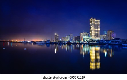 Manila, Philippines - Apr 12, 2017. View of Manila Bay from Harbour Square at night in Manila, Philippines.