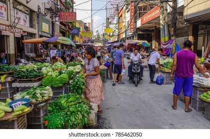 Manila, Philippines - Apr 12, 2017. People at vegetable market in Manila, Philippines. Manila is the capital of the Philippines and the center of governance, education and finance.