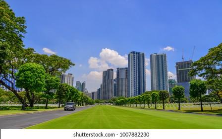 Manila, Philippines - Apr 14, 2017. Manila American Cemetery and Memorial with cityscape. Cemetery is located in Fort Bonifacio, in Taguig City, Manila.