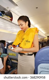 Manila, Philippines - April 19, 2015: Cebu Pacific flight attendant doing her checking duty before the flight departure. Cebu Pacific is one of the most popular flying agencies in the Philippines.