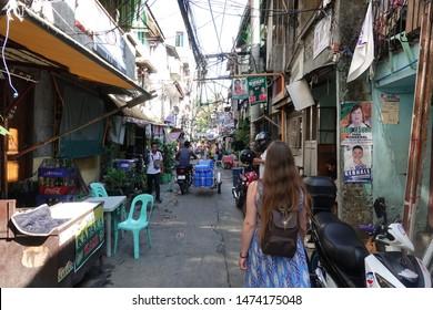 Manila, Philippines - april 2019: Slum streets and people in the slums of Manila