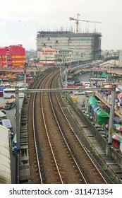MANILA, PHILIPPINES - APRIL 22, 2015. LRT railtrack at EDSA train station in Manila, Philippines. LRT serves 579,000 passengers each day. Its 31 stations along over 31 kilometers.