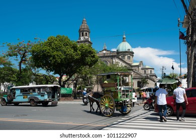 MANILA - PHILIPPINES, APRIL 24, 2017; Horse Drawn Calesa waiting for tourists in Intramuros, a historical part of Manila. Manila Cathedral located in the Intramuros district of Manila , Philippines