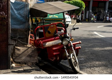 Manila, PHILIPPINES - AUGUST 20, 2019: Daily life in Manila. A old red tricycle on the street of Manila. Tricycle is popular vehicle in Philippines.