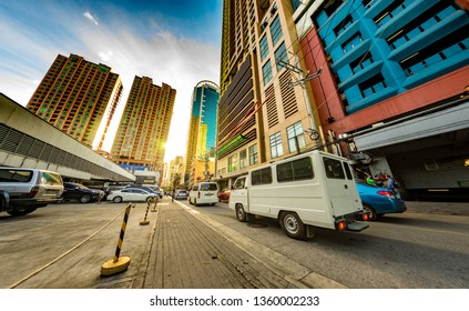 MANILA, PHILIPPINES - CIRCA MARCH 2018: View on daily life on the streets of the city as cars and pedestrians pass by during the day circa March, 2018 in Manila, Philippines.