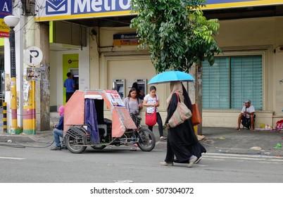 Manila, Philippines - Dec 20, 2015. People walking on street at EDSA district in Manila, Philippines.