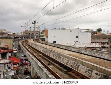 Manila, Philippines - Dec 20, 2015. Skytrain track at EDSA train station in Manila, Philippines. LRT serves 579,000 passengers each day.