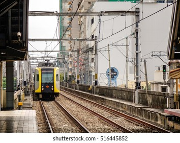 Manila, Philippines - Dec 20, 2015. LRT train coming to EDSA train station in Manila, Philippines. LRT serves 579,000 passengers each day.