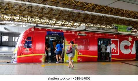 Manila, Philippines - Dec 20, 2015. People coming to LRT train at EDSA train station in Manila, Philippines. LRT serves 579,000 passengers each day.