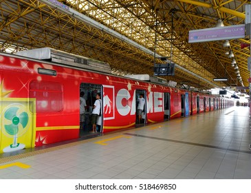 Manila, Philippines - Dec 20, 2015. A LRT train stopping at EDSA train station in Manila, Philippines. LRT serves 579,000 passengers each day.