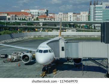 Manila, Philippines - Dec 21, 2015. Passenger airplane docking at NAIA Airport in Manila Philippines. In 2017, NAIA handled a record-breaking annual passenger traffic of 42 millions.