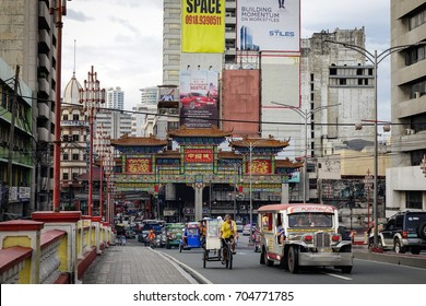 Manila, Philippines - Dec 21, 2015. Traffic on street at Chinatown in Manila, Philippines. Manila Chinatown is one of the largest and oldest in the world.