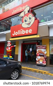 MANILA, PHILIPPINES - DECEMBER 7, 2017: People visit Jollibee fast food restaurant in Manila, Philippines. Jollibee operates 1100 restaurants (950 in Philippines).