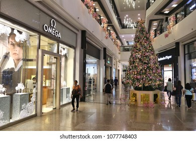 MANILA, PHILIPPINES - DECEMBER 7, 2017: People visit Greenbelt shopping center in Makati City, Metro Manila. The mall is owned by Ayala Corporation, largest Philippine corporation by assets.