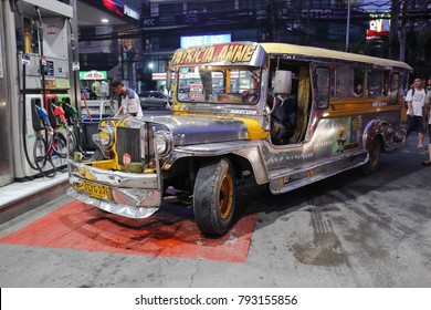 MANILA, PHILIPPINES - DECEMBER 9, 2017: Jeepney at a gas station on December 9, 2017 in Manila.